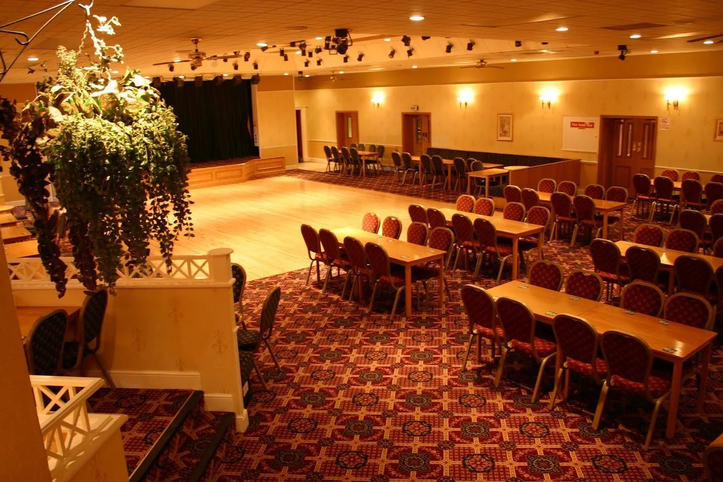 Standard Triumph Club function room with dance floor and long table seating