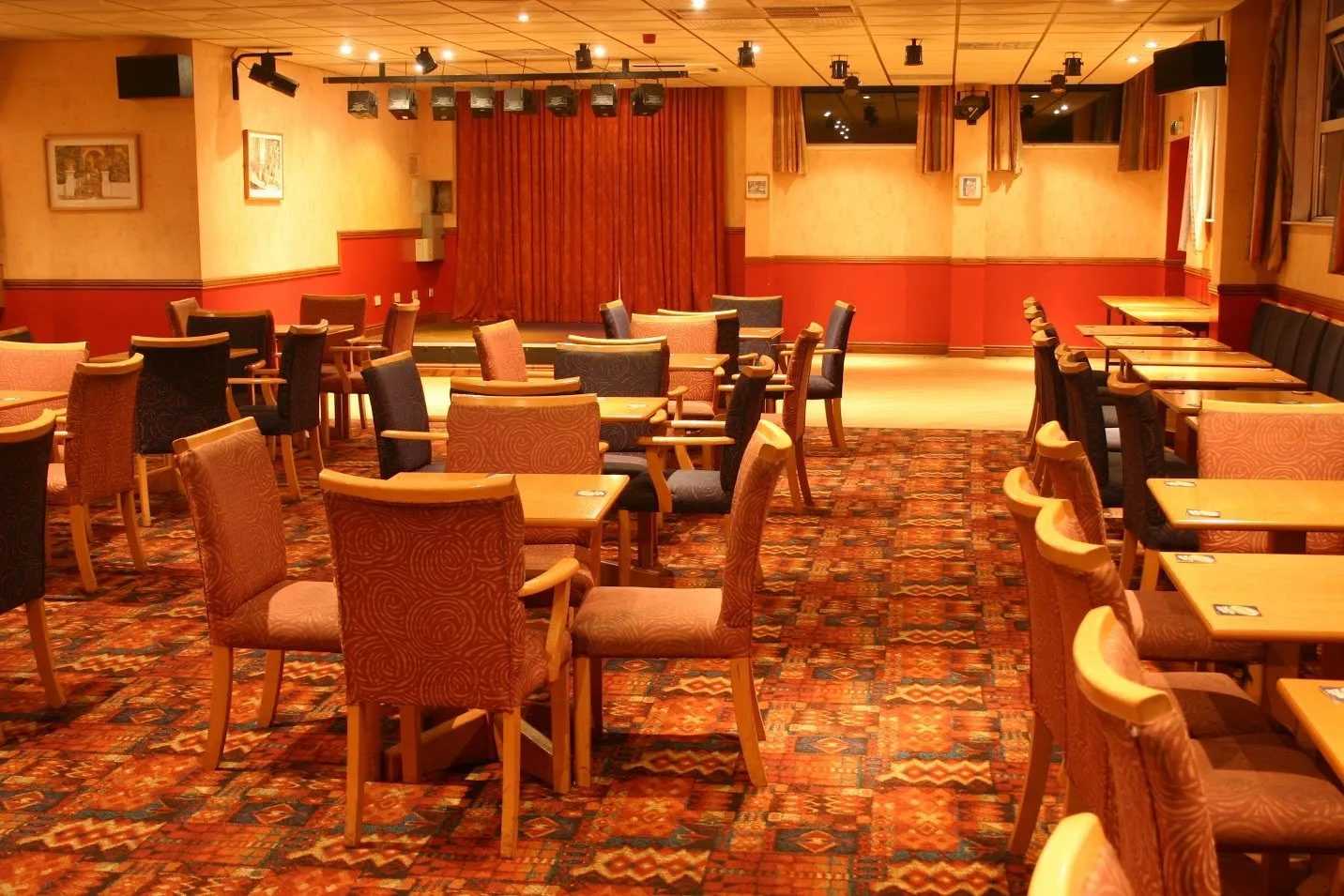 Standard Triumph Club function room with tables and chairs