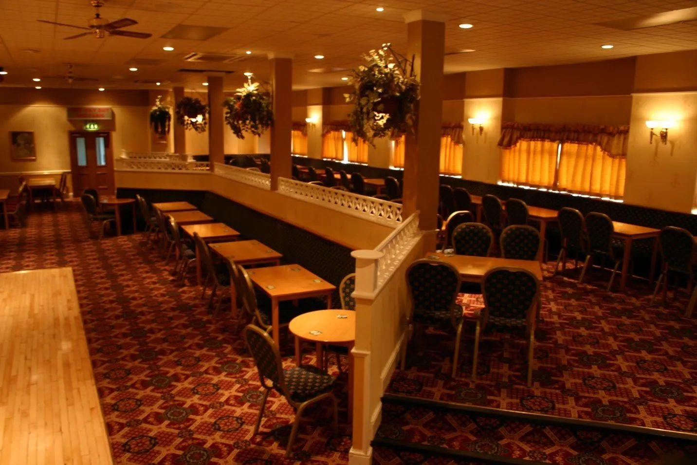Standard Triumph Club function room with higher tier tables and chairs